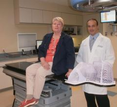 The high-level precision afforded by the Protura Robotic Patient Positioning System made all the difference in cancer treatment for patient Kathy Kelly, shown with her doctor, Joseph Bargellini.