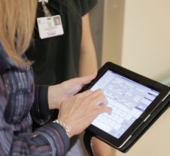 Bethesda RIS/PACS Admisitrator Anne Osowski accessing the system on an iPad
